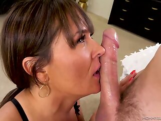 Elexis Monroe is wearing erotic, black lingerie while kneeling on the floor and sucking dick brunette big tits