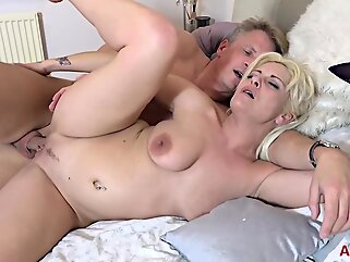 Kelly Cummings is a slutty mature blonde who likes when her best friends husband is fucking her blonde big tits
