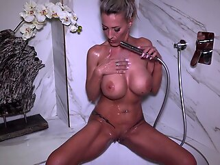 Busty blonde milf, Lana Vegas is alone in a hotel room and in the mood to masturbate blonde big tits