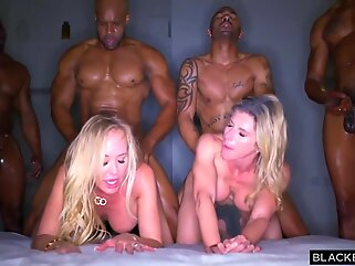 Blonde lady is often orgying with many black guys, until she ends up completely exhausted blonde big tits