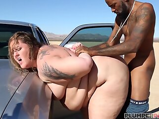 Fat woman is eagerly sucking a black dick outdoors and expecting a massive facial cumshot big cock bbw